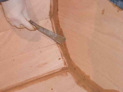 Scraping off excess epoxy
