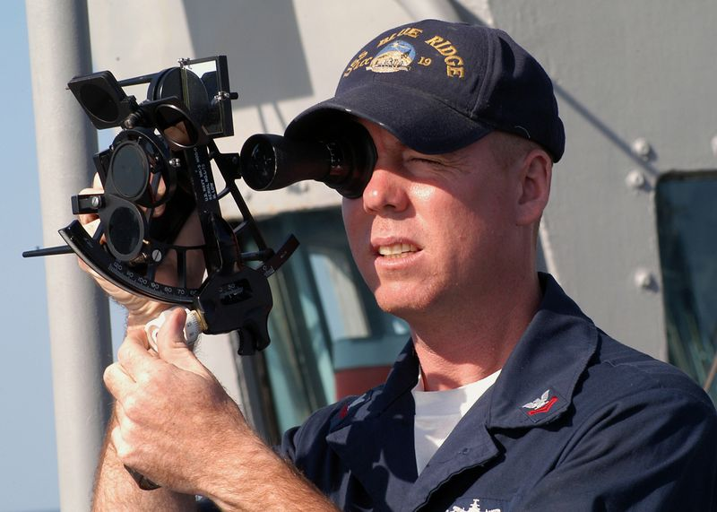 US_Navy_031025-N-8955H-005_Quartermaster_2nd_Class_Martineau,_from_Ft._Lauderdale,_Fla.,_uses_a_sextant_to_shoot_the_sun_line_from_the_port_bridge_wing_of_USS_Blue_Ridge_(LCC_19)
